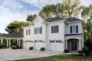 White house with three white garage doors