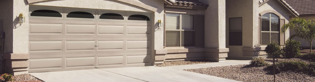 Front of home with tan garage door