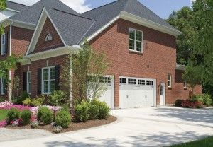 Brick home with white garage door